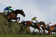Comply Or Die ridden by Timmy Murphy (21), Don't Push It ridden by A.P McCoy (1) and The Midnight Club ridden by Ruby Walsh (11) all clear 'The Chair' during The John Smith's Grand National Steeple Chase at Aintree Racecourse on April 9, 2011 in Liverpool, England.
