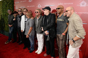 (L-R) Recording artists Chad Smith, Robin Zander, Daxx Nielsen, Tom Petersson, Michael Anthony, Sammy Hagar, Rick Nielsen, Vic Johnson and fashion designer John Varvatos attend the John Varvatos 13th Annual Stuart House benefit presented by Chrysler with Kids' Tent by Hasbro Studios at John Varvatos Boutique on April 17, 2016 in West Hollywood, California.