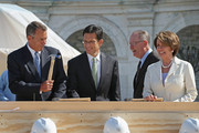 """Speaker of the House John Boehner (R-OH) (L) jokingly wields his hammer with (L-R) House Majority Leader Eric Cantor (R-VA), Sen. Lamar Alexander (R-TN) and House Minority Leader Nancy Pelosi (D-CA) before the """"First Nail"""" ceremony, signifying the start of construction of the 2013 Inaugural Platform on the West Front of the U.S. Captiol September 20, 2012 in Washington, DC. The winner of the November 6 presidential election will be sworn in on the platform on January 21, 2013."""