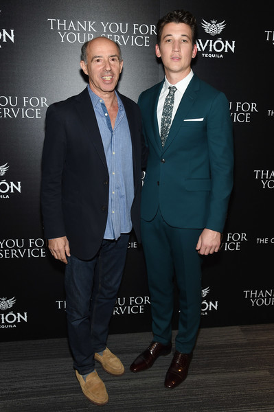 The Cinema Society Host a Screening of DreamWorks and Universal Pictures' 'Thank You for Your Service' [suit,formal wear,fashion,tuxedo,premiere,white-collar worker,event,footwear,pantsuit,blazer,miles teller,jon kilik,thank you for your service,57 west,the landmark,new york city,universal pictures,dreamworks,cinema society host a screening of dreamworks,screening]