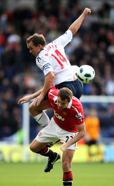Jonny Evans Kevin Davies of Bolton Wanderers tangles with Jonny Evans of Manchester United during the Barclays Premier League match between Bolton Wanderers and Manchester United at the Reebok Stadium on September 26, 2010 in Bolton, England.