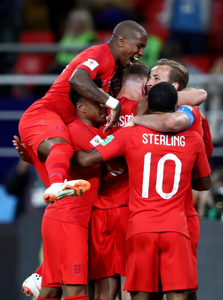 Colombia vs. England: Round of 16 - 2018 FIFA World Cup Russia [player,football player,red,sports,team sport,tournament,sport venue,sports equipment,ball game,team,harry kane,team mates,goal,penalty,russia,england,colombia,spartak stadium,round,2018 fifa world cup]
