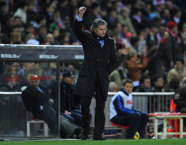 Jose Mourinho Head coach Jose Mourinho of Real Madrid clenches his fist as he celebrates after his side scored the opening goal during the quarter-final Copa del Rey second leg match between Atletico Madrid and Real Madrid and at Vicente Calderon Stadium on January 20, 2011 in Madrid, Spain.