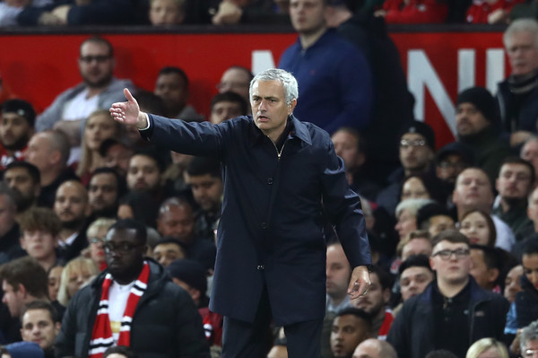 Manchester United v Manchester City - EFL Cup Fourth Round [crowd,fan,audience,event,sport venue,coach,championship,manager,gesture,jose mourinho,v,team instructions,manchester,manchester united,manchester city,efl,round,match,efl cup]