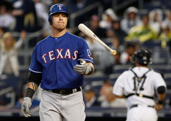 Josh Hamilton Josh Hamilton #32 of the Texas Rangers flips his bat after striking out in the first inning against the New York Yankees on June 14, 2011 at Yankee Stadium in the Bronx borough of New York City.