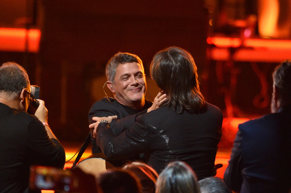 The 20th Annual Latin GRAMMY Awards – Person Of The Year Gala – Show [event,yellow,interaction,performance,conversation,crowd,person of the year gala,audience,juanes,alejandro sanz,latin grammy awards,las vegas,latin recording academy,show,gala,person of the year]