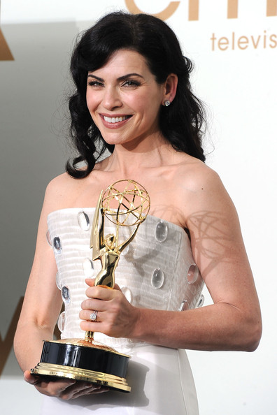 Press Room Shots from the Emmy Awards [outstanding lead actress in a drama series,the good wife,dress,hairstyle,shoulder,arm,cocktail dress,muscle,photography,award,black hair,fashion accessory,julianna margulies,primetime emmy awards,room,press room,nokia theatre l.a. live,los angeles,california,annual primetime emmy awards]