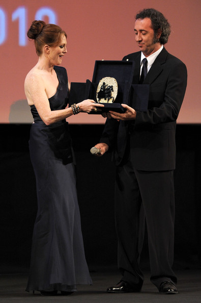 Actress Julianne Moore receives the Marc'aurelio Acting Award from Paolo Sorrentino during the 5th International Rome Film Festival at Auditorium Parco Della Musica on November 2, 2010 in Rome, Italy.