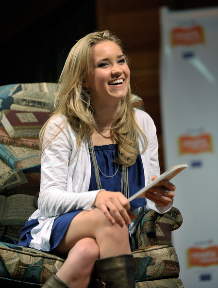 Actress Emily Osment reads to children at Jumpstart?s Read for the Record at the LA Public Library on October 8, 2009 in Los Angeles, California.