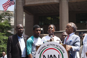 Trayvon Martin's mother Sybrina Fulton speaks at a podium as (L-R) family attorney Benjamin Crump, Trayvon Martin's brother Jahvaris Fulton and Rev. Al Sharpton attend a rally honoring Trayvon Martin organized by the National Action Network outside One Police Plaza in Manhattan on July 20, 2013 in New York City.  Demonstrators have gathered in various cities across the country to protest the acquittal of neighborhood watchman George Zimmerman and press for his federal prosecution in the shooting death of teenager Trayvon Martin.