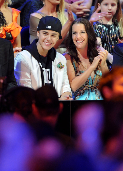Justin Bieber Musician Justin Bieber and mother Pattie Mallette attend the 2011 CMT Music Awards at the Bridgestone Arena on June 8, 2011 in Nashville, Tennessee.