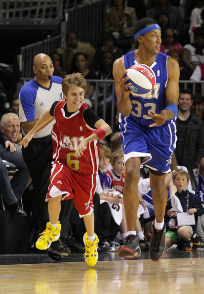 Justin Bieber Justin Bieber (L) and Scottie Pippen play at the 2011 ...