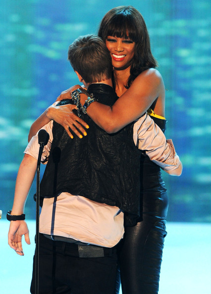 Justin Bieber Singer Justin Bieber (L) and TV personality Tyra Banks onstage during the 2011 Teen Choice Awards held at the Gibson Amphitheatre on August 7, 2011 in Universal City, California.