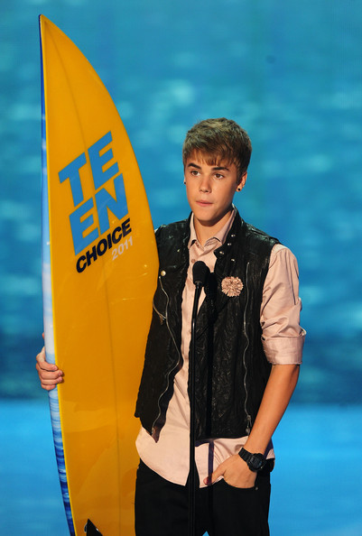 Justin Bieber Singer Justin Bieber accepts the Choice Male Artist award onstage during the 2011 Teen Choice Awards held at the Gibson Amphitheatre on August 7, 2011 in Universal City, California.