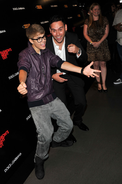 Justin Bieber Justin Bieber and Scooter Braun attend the Dolce & Gabbana celebration during Fashion's Night Out at Dolce & Gabbana Boutique on September 8, 2011 in New York City.
