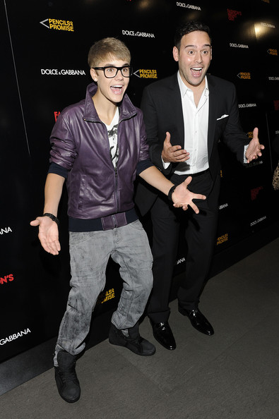 Justin Bieber Justin Bieber and Scooter Braun attend the Dolce & Gabbana Boutique on September 8, 2011 in New York City.