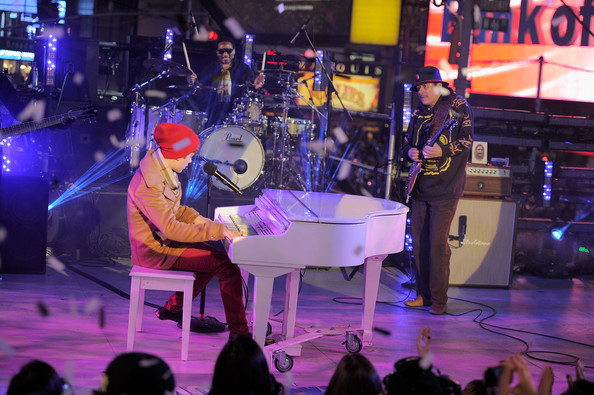 Justin Bieber Musicians Justin Bieber and Carlos Santana perform at New Year's Eve 2012 in Times Square on December 31, 2011 in New York City.