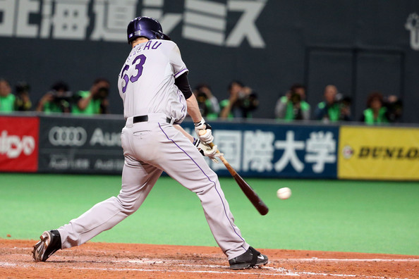 Samurai Japan v MLB All Stars [sports,baseball park,baseball equipment,sport venue,baseball player,bat-and-ball games,ball game,player,baseball uniform,team sport,game,justin morneau,v,double,sapporo dome,japan,samurai japan,mlb all stars,colorado rockies.,game]
