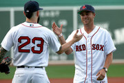 Golfer Justin Thomas shakes hands with Blake Swihart #23 of the Boston Red Sox after Thomas threw out the first pitch at Fenway Park before a game between the Boston Red Sox and the Miami Marlins on August 29, 2018 in Boston, Massachusetts.