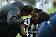 Patrice Evra of Juventus FC receives treatment during the Serie A match between Juventus FC and AC Chievo Verona at Juventus Arena on January 25, 2015 in Turin, Italy.