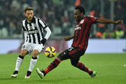 Claudio Marchisio (L) of Juventus FC is challenged by Michael Essien of AC Milan during the Serie A match between Juventus FC and AC Milan at Juventus Arena on February 7, 2015 in Turin, Italy.
