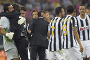 Juventus FC manager Antonio Conte celebrates a wictory with Gianluigi Buffon (L) at the end the Serie A match between Juventus FC and AC Milan on October 2, 2011 in Turin, Italy.