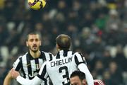 Giorgio Chiellini (L) of Juventus FC clashes with Giampaolo Pazzini of AC Milan during the Serie A match between Juventus FC and AC Milan at Juventus Arena on February 7, 2015 in Turin, Italy.