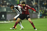 Carlos Tevez (L) of Juventus FC competes with Gabriel Paletta of AC Milan during the Serie A match between Juventus FC and AC Milan at Juventus Arena on February 7, 2015 in Turin, Italy.