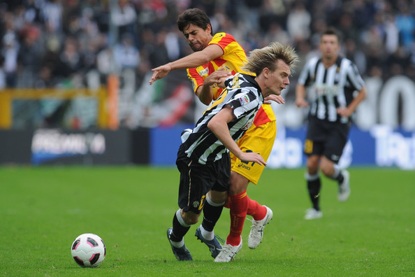 Milos Krasic of Juventus FC clashes with Carlos Grossmuller  of US Lecce during the Serie A match between Juventus FC and US Lecce at Olimpico Stadium on October 17, 2010 in Turin, Italy.