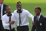 Patrice Evra, Paul Pogba and Tonga Coleman of Juventus share a light moment while inspecting the pitch at Estadio Santiago Bernabeu ahead of their UEFA Champions League Semi final, Second Leg match against Real Madrid on May 12, 2015 in Madrid, Spain.