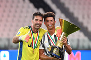 Gianluigi Buffon and Cristiano Ronaldo of Juventus FC celebrate with the trophy after the Serie A match between Juventus and  AS Roma at Allianz Stadium on August 1, 2020 in Turin, Italy.
