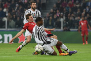 Patrice Evra and Thomas Mueller Photos Photo