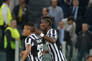 Arturo Vidal of Juventus (L) celebrates with team-mate Paul Pogba after scoring his team's first goal from a penalty to equalise UEFA Champions League Group B match between Juventus and Galatasaray AS at Juventus Arena on October 2, 2013 in Turin, Italy.