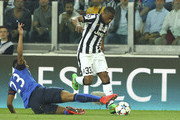 Patrice Evra (R) of Juventus is challenged by Anthony Martial (L) of AS Monaco FC during the UEFA Champions League Quarter Final First Leg match between Juventus and AS Monaco FC at Juventus Arena on April 14, 2015 in Turin, Italy.