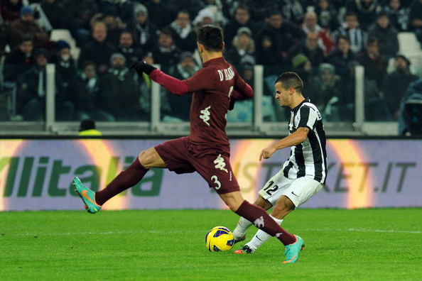 Sebastian Giovinco  (R) of Juventus scores a goal during the Serie A match between Juventus and Torino FC at Juventus Arena on December 1, 2012 in Turin, Italy.