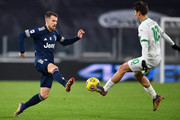 Aaron Ramsey of Juventus F.C. battles for possession with Filip Djuricic of Sassuolo during the Serie A match between Juventus and US Sassuolo at Allianz Stadium on January 10, 2021 in Turin, Italy. Sporting stadiums around Italy remain under strict restrictions due to the Coronavirus Pandemic as Government social distancing laws prohibit fans inside venues resulting in games being played behind closed doors.