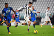 Aaron Ramsey of Juventus F.C. runs with the ball under pressure from Marvin Zeegelaar of Udinese Calcio during the Serie A match between Juventus and Udinese Calcio at Allianz Stadium on January 03, 2021 in Turin, Italy. Sporting stadiums around Italy remain under strict restrictions due to the Coronavirus Pandemic as Government social distancing laws prohibit fans inside venues resulting in games being played behind closed doors.