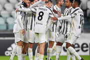 Cristiano Ronaldo of Juventus F.C.  celebrates with teammates Aaron Ramsey, Weston McKennie and Alex Sandro after scoring their team's first goal during the Serie A match between Juventus and Udinese Calcio at Allianz Stadium on January 03, 2021 in Turin, Italy. Sporting stadiums around Italy remain under strict restrictions due to the Coronavirus Pandemic as Government social distancing laws prohibit fans inside venues resulting in games being played behind closed doors.