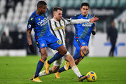 Aaron Ramsey of Juventus F.C. is tackled by Marvin Zeegelaar and Kevin Bonifazi of Udinese Calcio during the Serie A match between Juventus and Udinese Calcio at Allianz Stadium on January 03, 2021 in Turin, Italy. Sporting stadiums around Italy remain under strict restrictions due to the Coronavirus Pandemic as Government social distancing laws prohibit fans inside venues resulting in games being played behind closed doors.