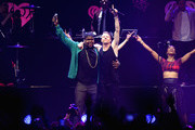 Recording artists Ray Dalton (L) and Macklemore (R) perform onstage during KIIS FM's Jingle Ball 2013 at Staples Center on December 6, 2013 in Los Angeles, CA.
