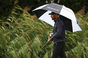 Alvaro Quiros of Spain holds a umbrella as the rain falls during the ProAm prior to the KLM Open held at The Dutch golf course on September 12, 2018 in Spijk, Netherlands.