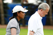Former Secretary of State Condoleezza Rice walks with Scott Ozanus of KPMG during the pro-am prior to the start of the KPMG Women's PGA Championship at Kemper Lakes Golf Club on June 26, 2018 in Kildeer, Illinois.