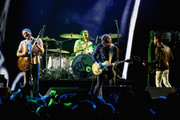 (L-R) Caleb Followill, Nathan Followill, Matthew Followill and Jared Followill of Kings of Leon perform onstage at 106.7 KROQ Almost Acoustic Christmas 2016 - Night 1 at The Forum on December 10, 2016 in Inglewood, California.