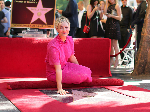 Actress Kaley Cuoco poses with her star on the Hollywood Walk of Fame October 29, 2014 in Hollywood, California.