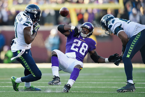 Image result for kam chancellor vs adrian peterson