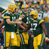 Davante Adams Photos - Davante Adams #17 of the Green Bay Packers celebrates with quarterback Matt Flynn #10 and Alex Gillett #1 after scoring against the Kansas City Chiefs in the first quarter during the preseason game on August 28, 2014 at Lambeau Field in Green Bay, Wisconsin. - Kansas City Chiefs v Green Bay Packers