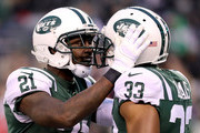 Morris Claiborne #21 and Jamal Adams #33 of the New York Jets celebrate after holding the Kansas City Chiefs on fourth down late in the fourth quarter during their game at MetLife Stadium on December 3, 2017 in East Rutherford, New Jersey.