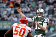 Josh McCown #15 of the New York Jets passes under pressure from Justin Houston #50 of the Kansas City Chiefs on December 03, 2017 at MetLife Stadium in East Rutherford, New Jersey.The New York Jets defeated the Kansas City Chiefs  38-31.
