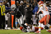 Vincent Brown #19 of the Oakland Raiders is brought down by Ron Parker #38 of the Kansas City Chiefs in the first quarter of the game at O.co Coliseum on November 20, 2014 in Oakland, California.