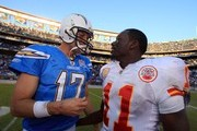 Quarterback Philip Rivers #17 of the San Diego Chargers greets ex-teammate Chris Chambers #11 of the Kansas City Chiefs after the Chargers 43-14 win over the Chiefs on November 29, 2009 at Qualcomm Stadium in San Diego, California.